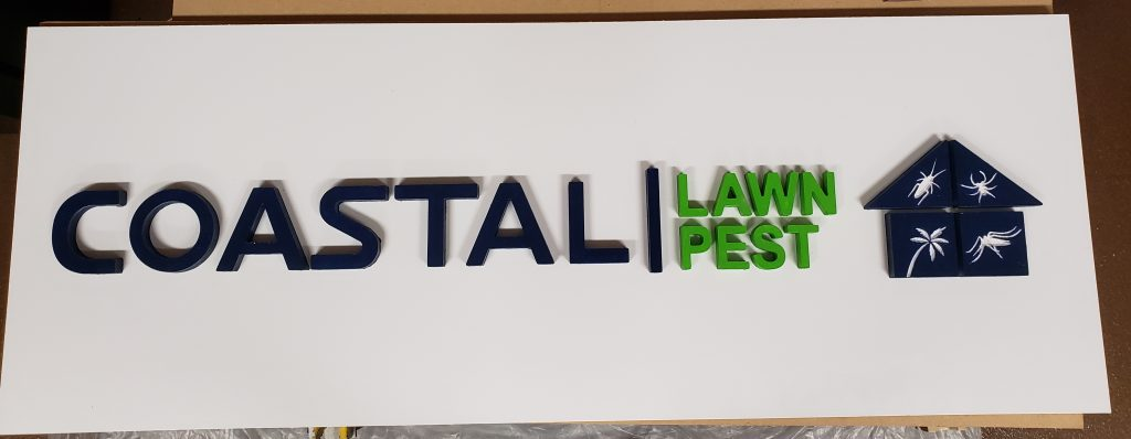 coastal lawn and pest wooden sign